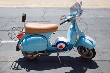 Light blue moped and helmet