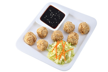 Chinese dishes, chicken balls with sesame seeds, Isolated on whi