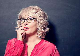 woman with glasses looking up - business rocks 11