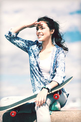 teenage girl with skate outside