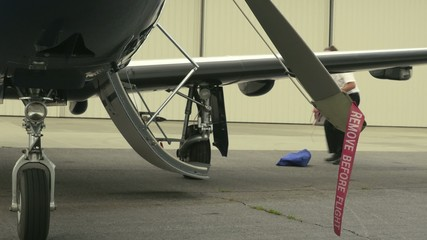 Pilot Prepares Post-Flight Safety Covers and Ribbons
