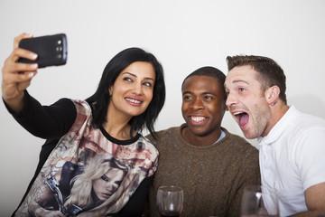 Three friends taking selfie
