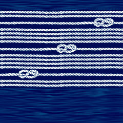 Seamless pattern with marine rope and knots on a blue background