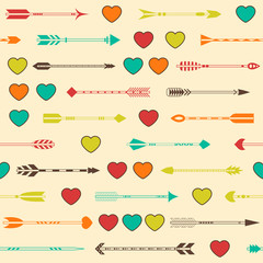 Seamless pattern with Indian arrows and hearts in various colors