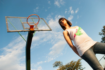 Casual teen on basketball court