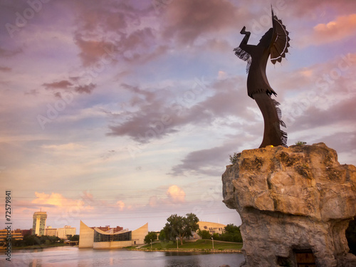 Tuinposter Artistiek mon. Beautiful Sunset With Keeper Of The Plains In Wichita Kansas
