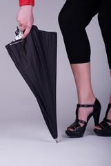 woman feets and studio umbrella