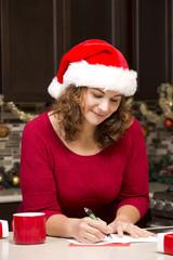 woman writing Christmas card