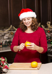 woman peeling orange