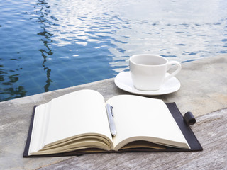 Coffee and Book with Pen Swimming Pool Travel Background