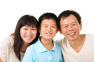 Indoor portrait of asian family isolated on white