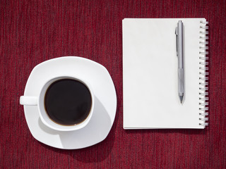 Coffee with book and Pen on Red Table Background top view