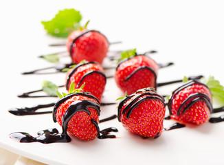 Fresh strawberries  in chocolate sauce .
