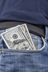 US Dollar notes in the front pocket.