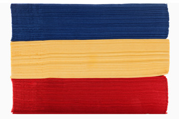 Stack of red yellow and blue napkins