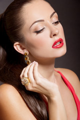 Fashion Woman Portrait in evening dress and with jewelery