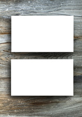 Blanks white business cards on a wooden background