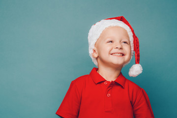 Boy in Santa red hat