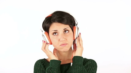 Sad Young Woman Listening Music with Headphones