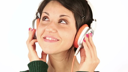 Smiling Young Woman Listening Music with Headphones