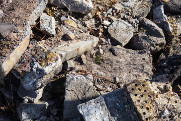 Heap of the damaged concrete blocks and bricks