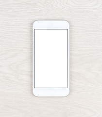Stylish white smartphone over table