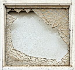 Broken dirty window on abandoned building