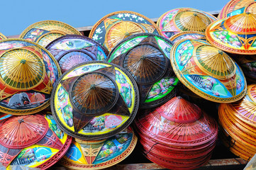 Traditional national hats sold on the local market.