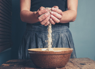 Young woman with oats