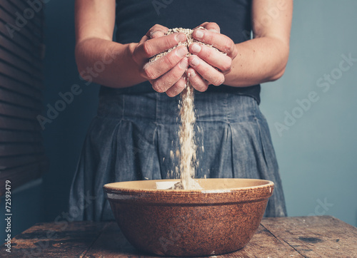 Young woman with oats - 72593479