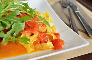 Italian pasta with vegetables and tomato sauce