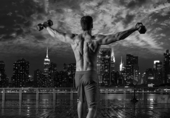 gym man rising hex dumbbells in New York city