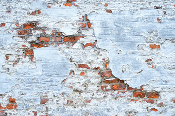 old red brick wall with white painting