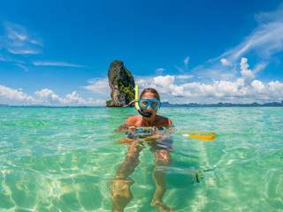 Beautiful woman snorkelling in Krabi Thailand