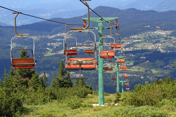 long mountain chairlift in summer