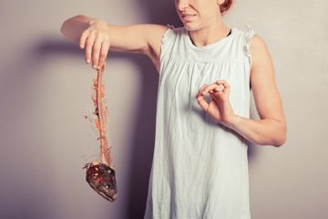 Disgusted woman with fish skeleton