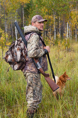 Man with dog out hunting