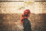 Young redhead woman walking in alley - 72596468