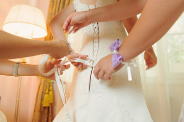 Tying Bow on Dress
