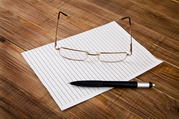 paper, pen and glasses