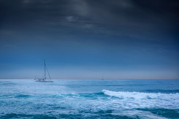 small yacht on a background of cold winter sea