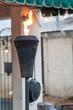 Black Metal Tiki Torch Flaming