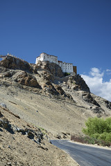 Ancient Buddhist temple on cliff over the road