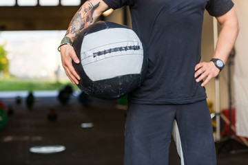 Fit Man Carrying Medicine Ball