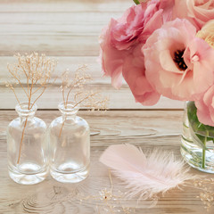 Vintage Still life with pink flowers in a vase with fearher and