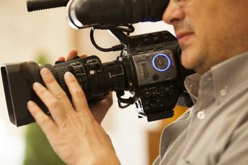 Detail of camera man at work.
