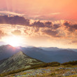 Beautiful Mountains -  sunset time. Hight peaks, clouds and red