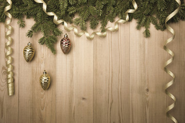 ChristmasVintage Background with fir tree, golden ribbon and dec