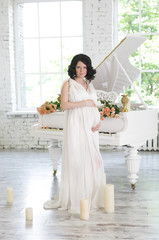 Glamour and style of young pregnant woman