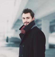 Vintage photo handsome stylish man brunette in black coat posing